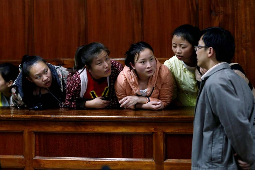 Taiwanese and Chinese nationals accused of suspected telecommunications fraud at the Milimani Law Courts in Nairobi, Kenya on Aug 5. They were later acquitted.