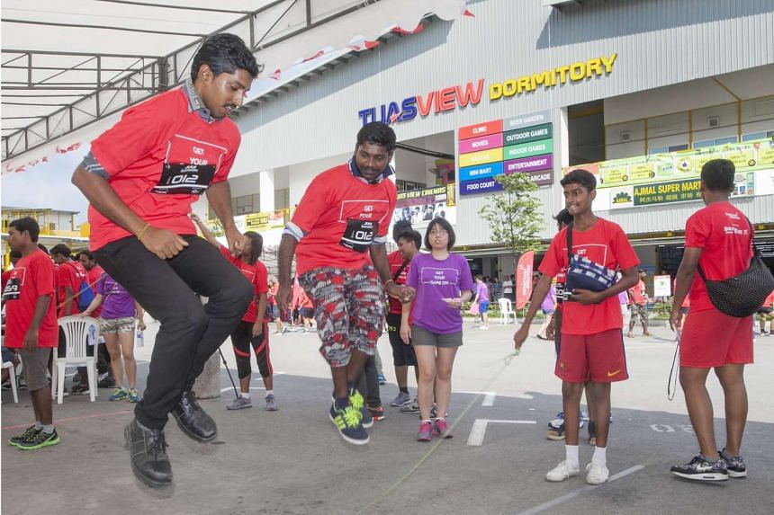 Local and foreign workers took part in a series of games at Tuas View Dormitory on Sunday (Aug 7), aimed at promoting social integration between Singaporeans and foreigners.