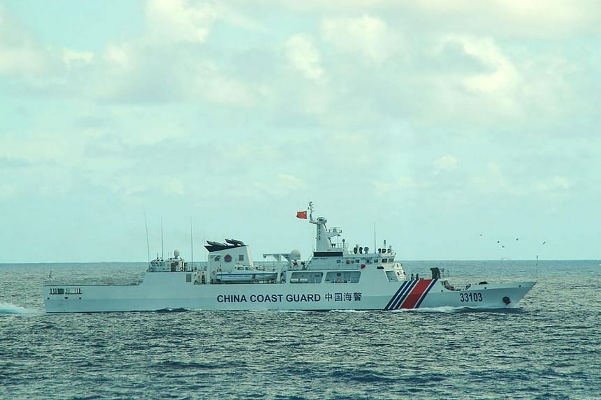 This picture taken on Aug 7 and released by the Japan Coast Guard shows the China coast guard ship 33103 sailing near the waters of disputed East China Sea islands.