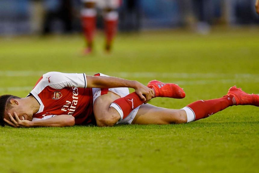 Arsenal's Gabriel Paulista lies injured during the  Arsenal vs Manchester City pre-season friendly at Ullevi Stadium in Gothenburg on August 7.