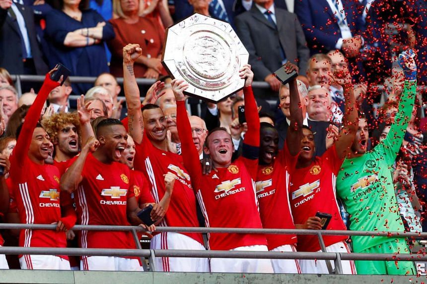 Manchester United's Wayne Rooney celebrates with the trophy after winning the FA Community Shield.