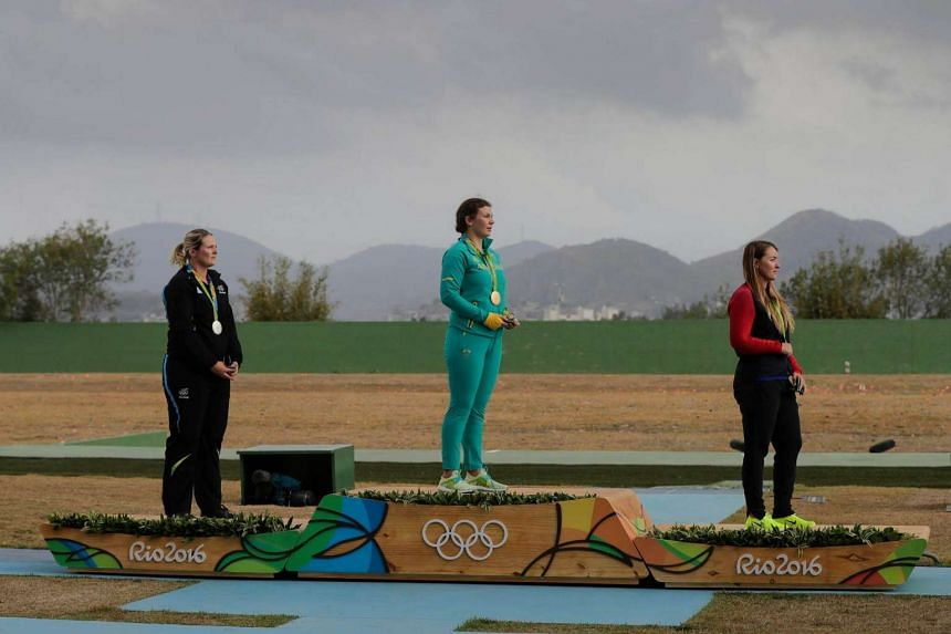 Gold medal winner Catherine Skinner of Australia (centre), silver medal winner Natalie Rooney of New Zeland (left) and bronze medal winner Corey Cogdell (right) of the US with their medals after women's Trap final of the Rio 2016 Olympic Games Shooti