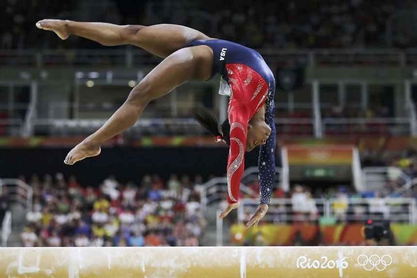 Simone Biles of the USA competes on the beam during the women's qualifications at the Rio 2016 Olympic Games.