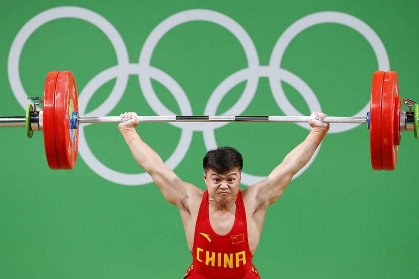 Long Qingquan of China competes during the men's 56kg category of the Rio 2016 Olympic Games Weightlifting events at the Riocentro in Rio de Janeiro, Brazil on August 7.