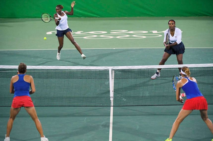 The Williams sisters in action during the match.