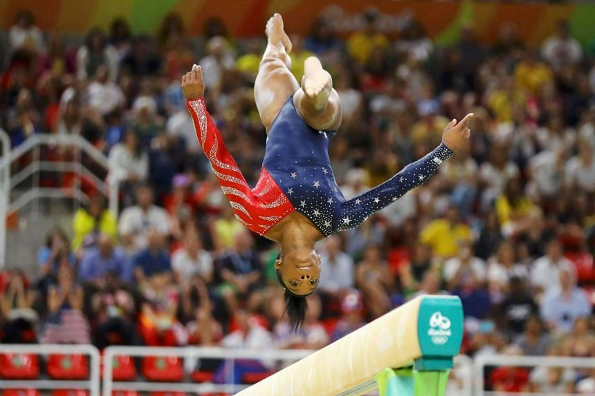 American Simone Biles, the reigning three-time all-around world champion, remains on track for five Olympic golds after qualifying for the all-around final.