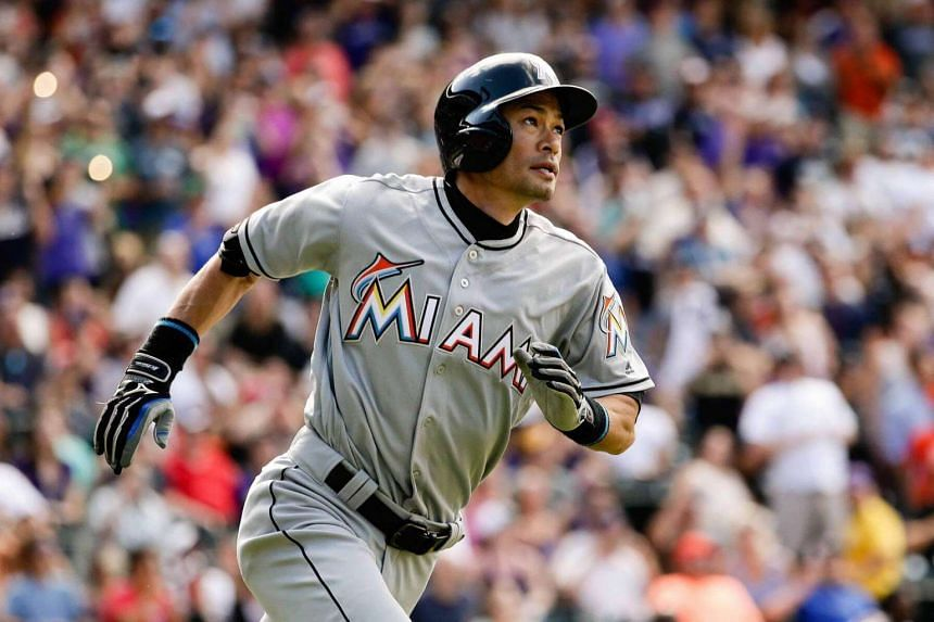 Miami Marlins center fielder Ichiro Suzuki watches his ball on a triple in the seventh inning against the Colorado Rockies at Coors Field in Denver, US on August 7.