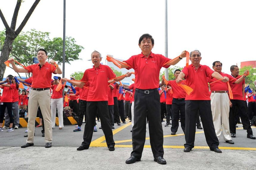 Minister for Transport Khaw Boon Wan also participated in the mass workout session as part of ComfortDelGro National Day Observance ceremony on Aug 8.