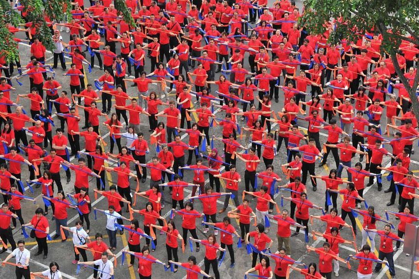 More than 1,200 ComfortDelGro staff stretched their way into Singapore's largest ever mass workout with resistance bands on Aug 8.