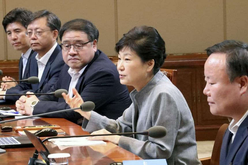 South Korean President Park Geun-hye (2nd right) chairs a meeting of senior secretaries at her office Cheong Wa Dae in Seoul, South Korea on August 8.