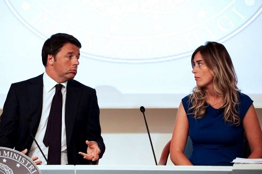 Italy's Prime Minister Matteo Renzi (left) speaks to Minister for Constitutional Reforms and Parliamentary Relations Maria Elena Boschi at a news conference in Rome, on Sept 1, 2014.