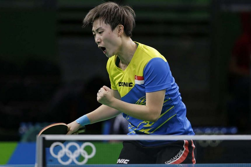 Feng Tianwei reacts after winning a point during the the Rio 2016 Olympic Games women's table tennis round 3 match, on Aug 8, 2016.