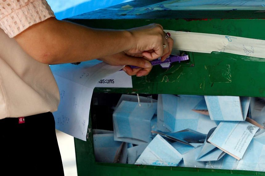 A Thai electoral worker prepares to start counting ballots at a polling station during a constitutional referendum vote in Bangkok on Aug 7, 2016.