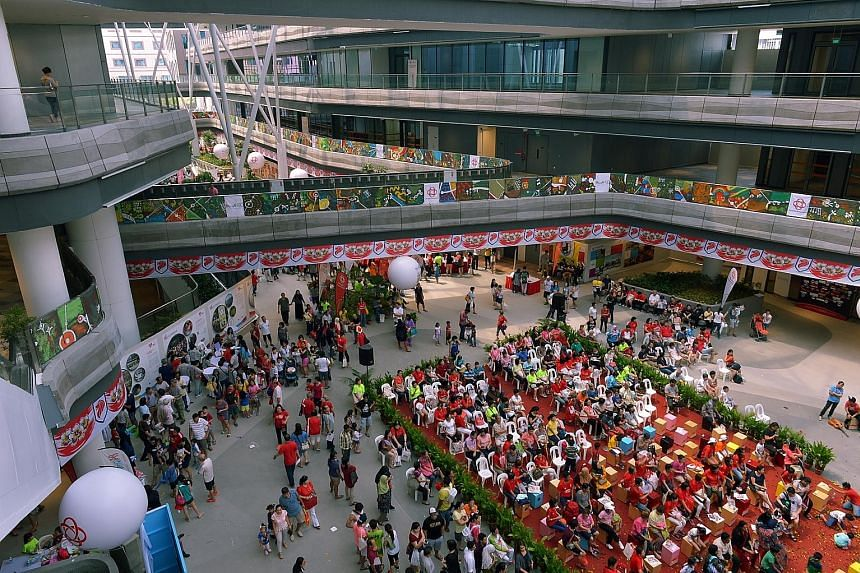 National Day celebrations yesterday at Our Tampines Hub, which will open in stages from November. Fully open by next June, it will have facilities such as a library, a gym and a performing arts auditorium.