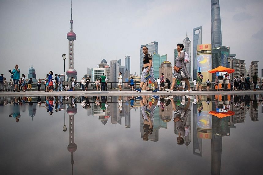 The Bund in Shanghai, overlooking the financial district of Pudong in the Chinese city. Market watchers remain divided on the outlook for China, which will release financial and economic data this week.