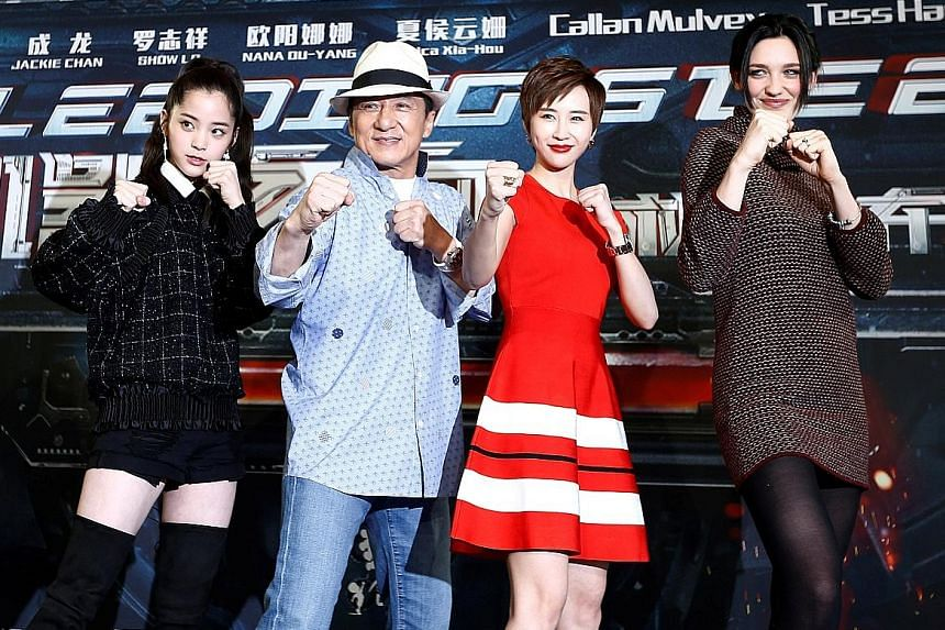 Jackie Chan with (from left) Ouyang Nana, Erica Xia-Hou and Tess Haubrich at the announcement of the beginning of production for Bleeding Steel in Sydney last month.