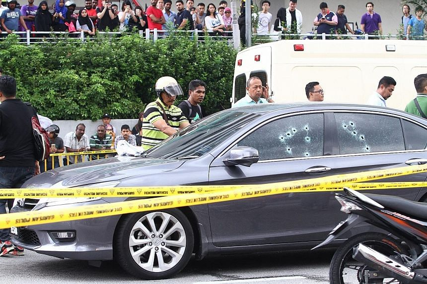 Moneylender V. Kandasamy was shot dead in his car (above) in front of a Kuala Lumpur mall on July 27. Realtor Renyce Wong was killed in her car (left), also in KL on July 6, allegedly on the orders of a businessman who owed her money.