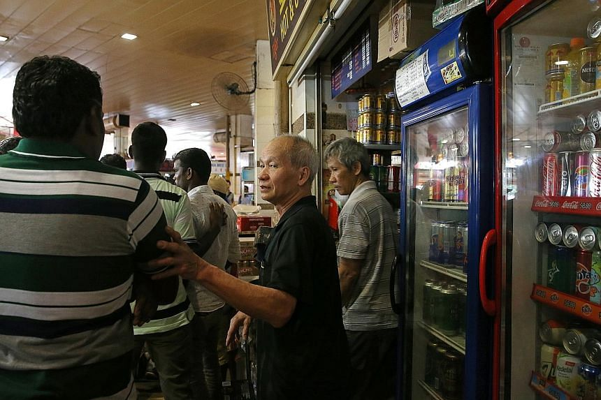 A stallholder at Tekka Food Centre informing patrons that he cannot sell alcohol after 6pm. Before this, customers could purchase and consume alcohol at the premises from 6am till midnight on Sundays, but the hours have now been shortened to 6pm.