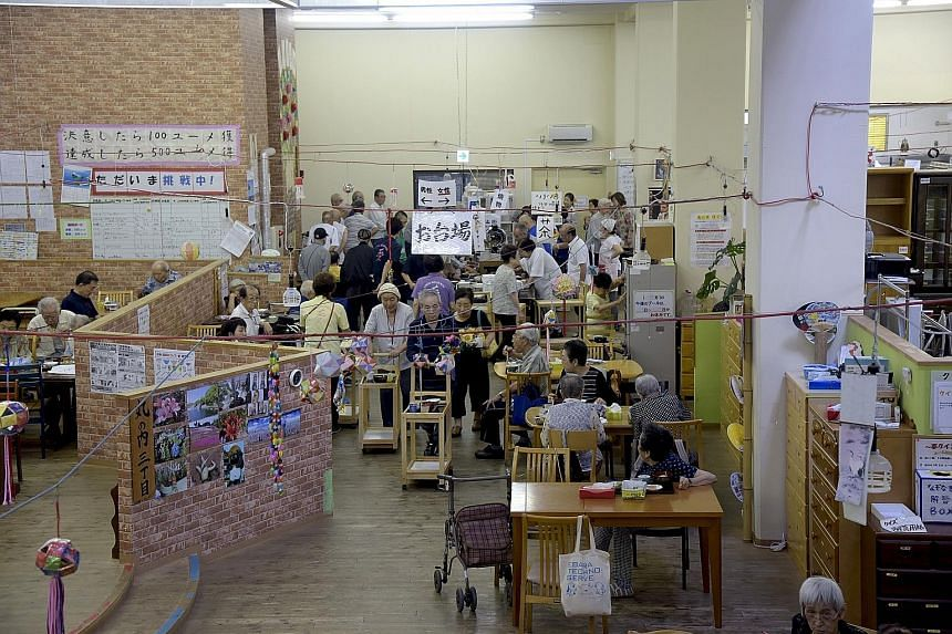 Unlike other centres, where staff serve the elderly, at Mizuumi, the elderly do most of the work themselves. At lunch, for instance, they collect their utensils, line up to choose their food and push a cart to take it to their tables. After eating, t
