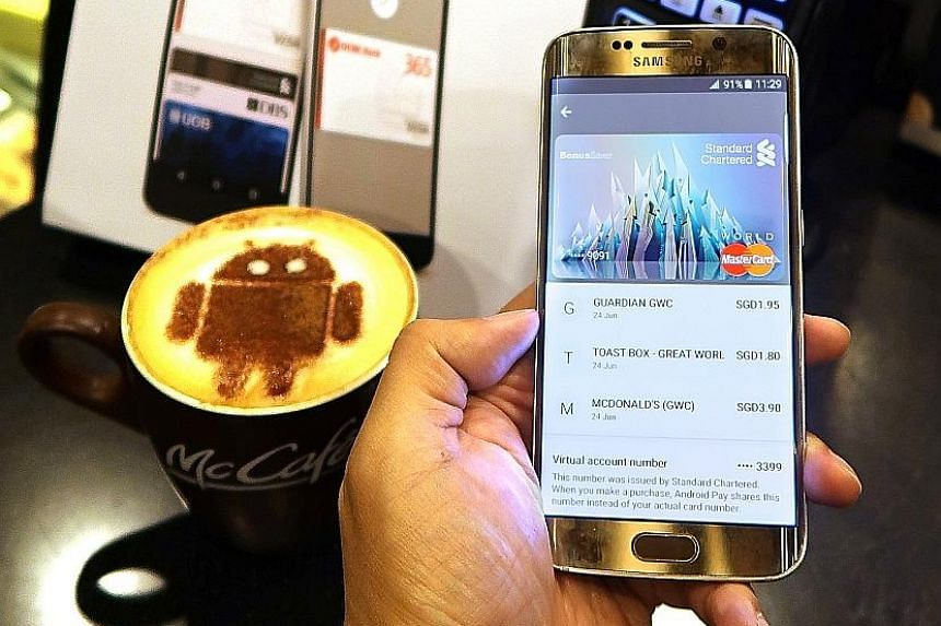 A customer using Google's Android Pay. Security and privacy concerns are cited as the main reasons for the slow sign-up rate for such e-wallet services.