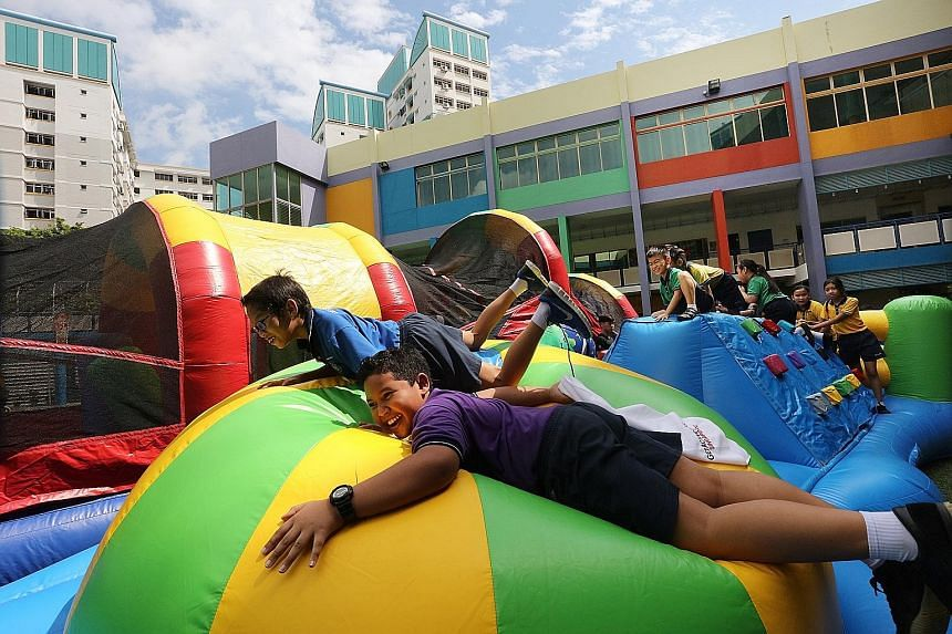 In another part of the school, pupils were having a great time tackling an inflatable obstacle course.