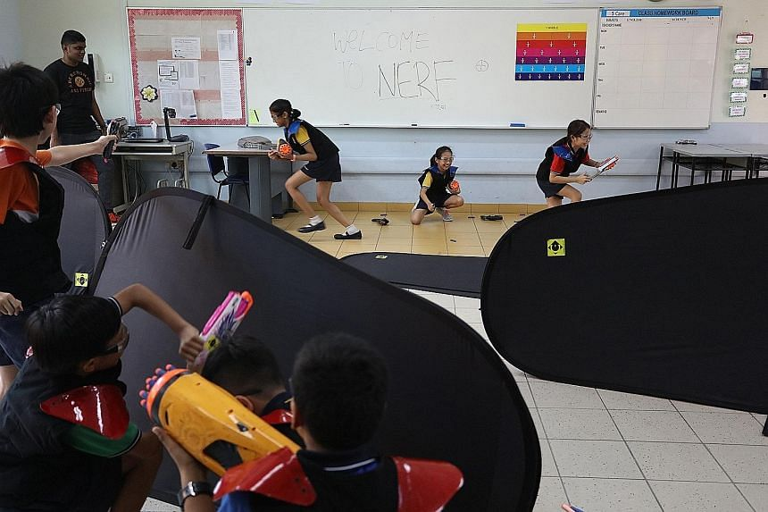 Primary 5 pupils from Meridian Primary during a Nerf gunbattle. The school had 22 sports activities spread out within its premises for the carnival that it had organised as part of this year's National Day celebrations.