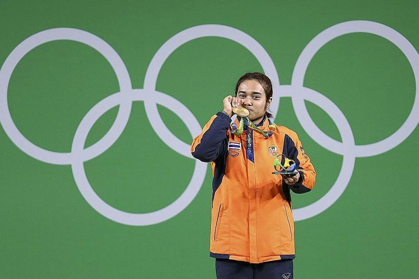 Vietnamese shooter Hoang Xuan Vinh (left) and Thai weightlifter Sopita Tanasan won South-east Asia's first two gold medals.