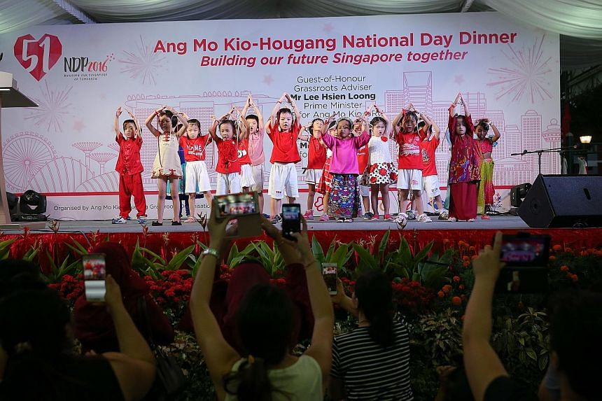Children performing at yesterday's Ang Mo Kio-Hougang National Day Dinner, attended by PM Lee and his fellow MPs, as well as around 1,300 residents. His National Day Message, recorded at the newly opened Safra clubhouse in Punggol, will be broadcast