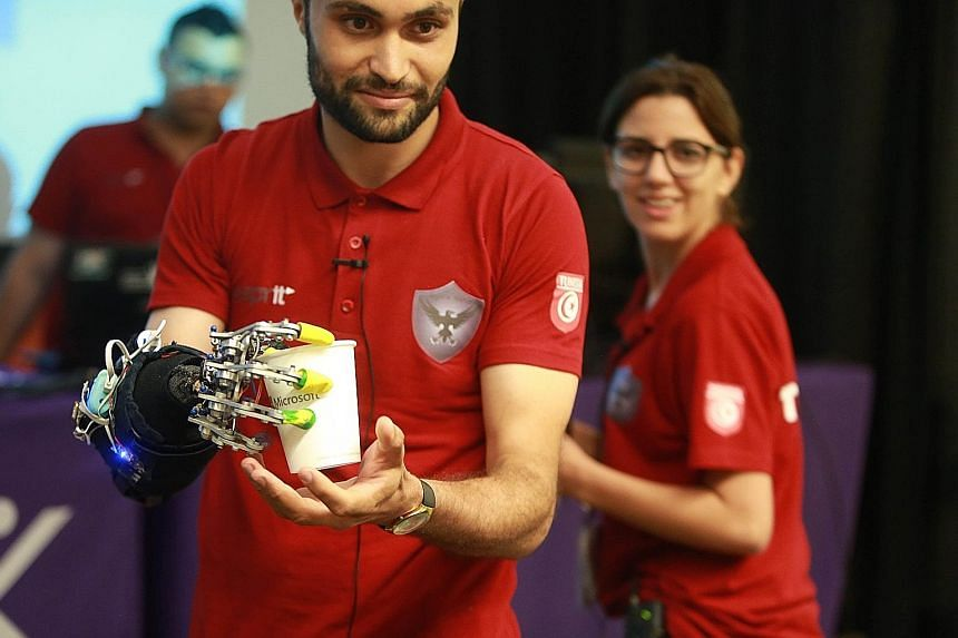 Students from around the world showcased their inventions at last month's Microsoft Imagine Cup World Finals. From left: Team Night's Watch member Mohamed Zied Cherif (above), who was born with a defect that prevented his hand from fully forming, wearing