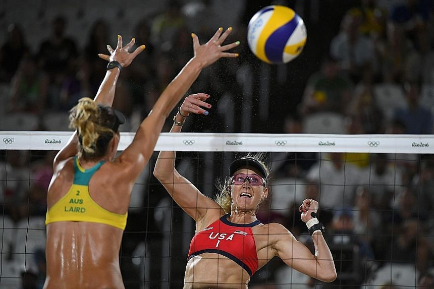 Above: A packed Beach Volleyball Arena watching the men's competition at Rio's famed Copacabana beach on Saturday night. Left: Australia's Nicole Laird vying with US player Kerri Walsh Jennings. The latter, who is a triple Olympic champion with Misty