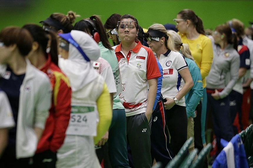 Singapore's Teo Shun Xie reacting to a bad shot during the 10m air pistol qualification round at the Olympic Shooting Centre. The Olympic first timer felt fine in the warm-up but admitted that nerves got the better of her in the end.
