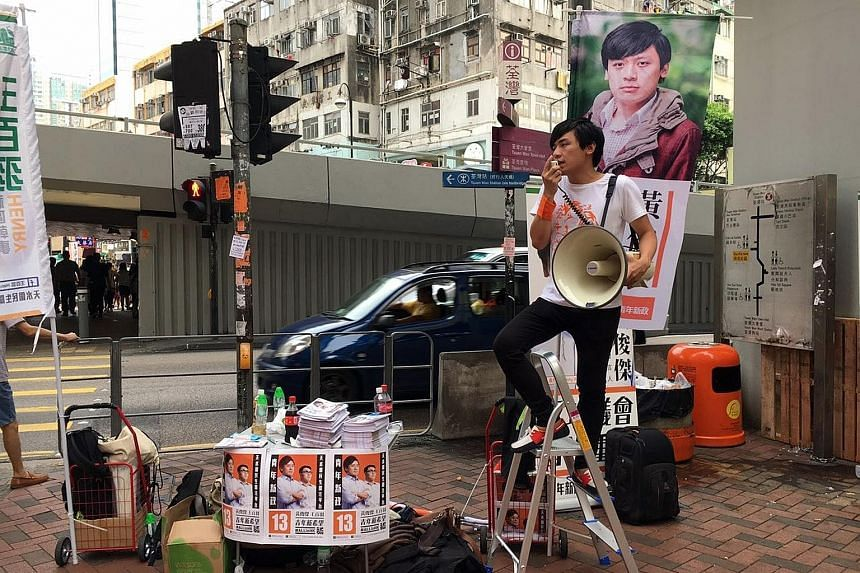 Localist party Youngspiration spokesman Kenny Wong Chun Kit campaigning in the streets in Hong Kong's Tsuen Wan district.