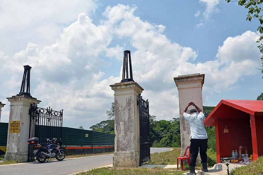 The cleaned and repaired gates were put back on their old posts at their new location - a new access road near Lorong Halwa.