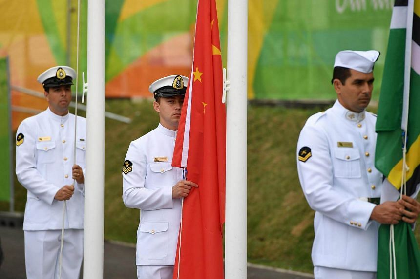 The Chinese flag is raised at the Athletes' Village ahead of the Rio Olympic Games.