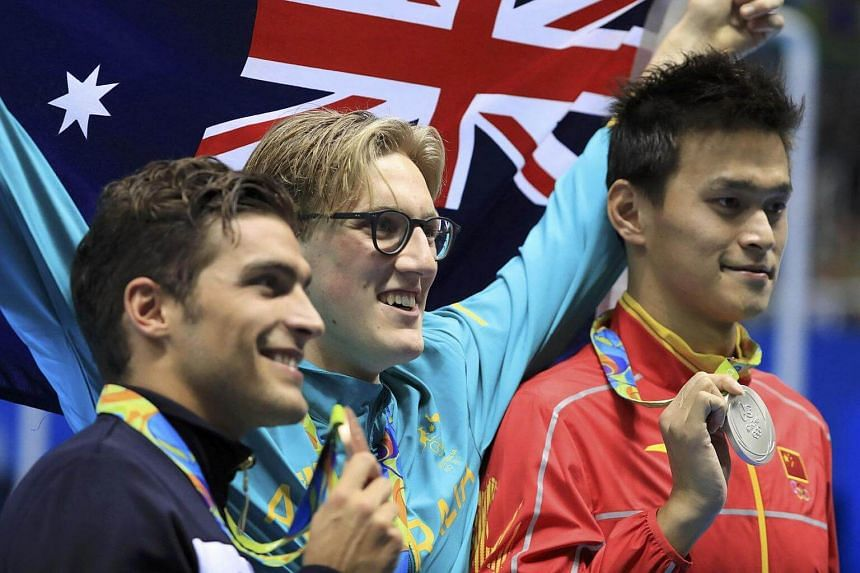 Australia's Mack Horton (centre) on the podium with China's Sun Yang (right) and Italy's Gabriele Detti after their 400m freestyle race.