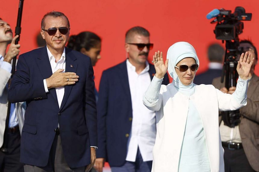 Turkish President Tayyip Erdogan and his wife Emine Gulbaran attend Democracy and Martyrs Rally on Sunday.