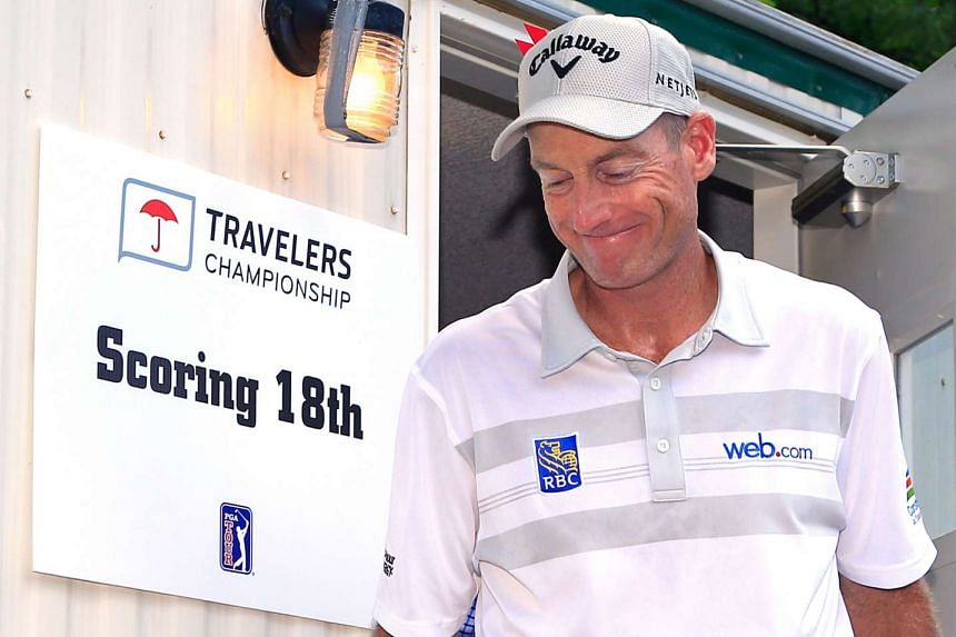 Jim Furyk of the US comes out of the scoring trailer after a shooting a record-setting 58 during the final round of the Travelers Championship on Sunday.