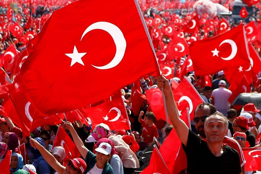 A man waves Turkey's national flag during the Democracy and Martyrs Rally in Istanbul on Sunday.