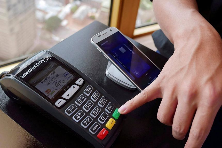 Samsung's new Samsung Pay mobile wallet system is demonstrated at its Australian launch in Sydney, on June 15.