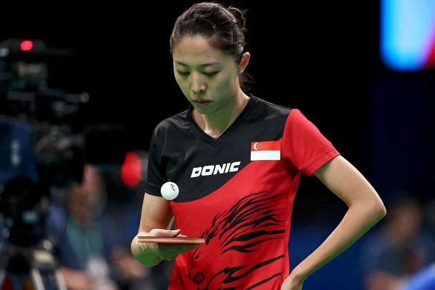 Yu Mengyu of Singapore bounces the ball on her paddle during play against Jian Fang Lay of Australia.