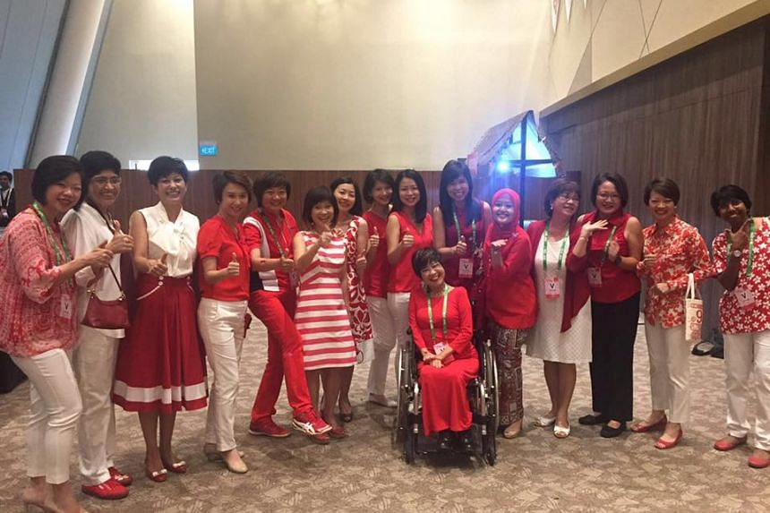 Ministers and MPs wear red and white to celebrate National Day at the National Stadium on Aug 9, 2016.