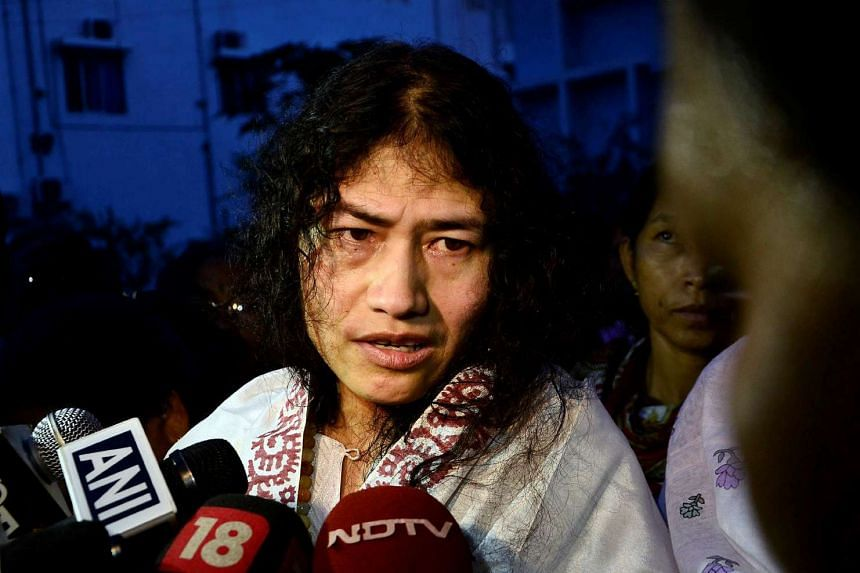 Indian human rights activist Irom Sharmila speaks to the media outside a prison hospital in Imphal, India, on Aug 20, 2014.