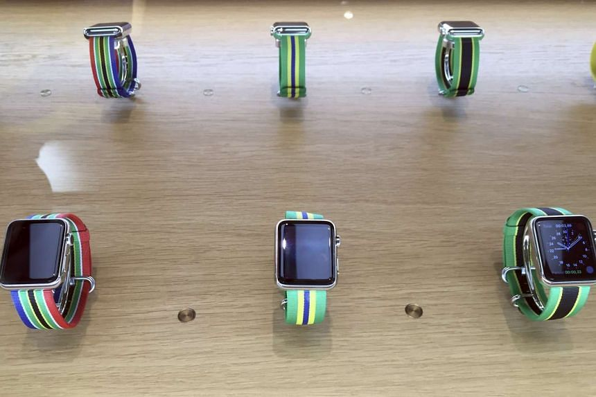 Apple watches with limited edition wristbands featuring national colours of teams competing in the Olympic Games in an Apple Store in Rio de Janeiro, on Aug 8, 2016.
