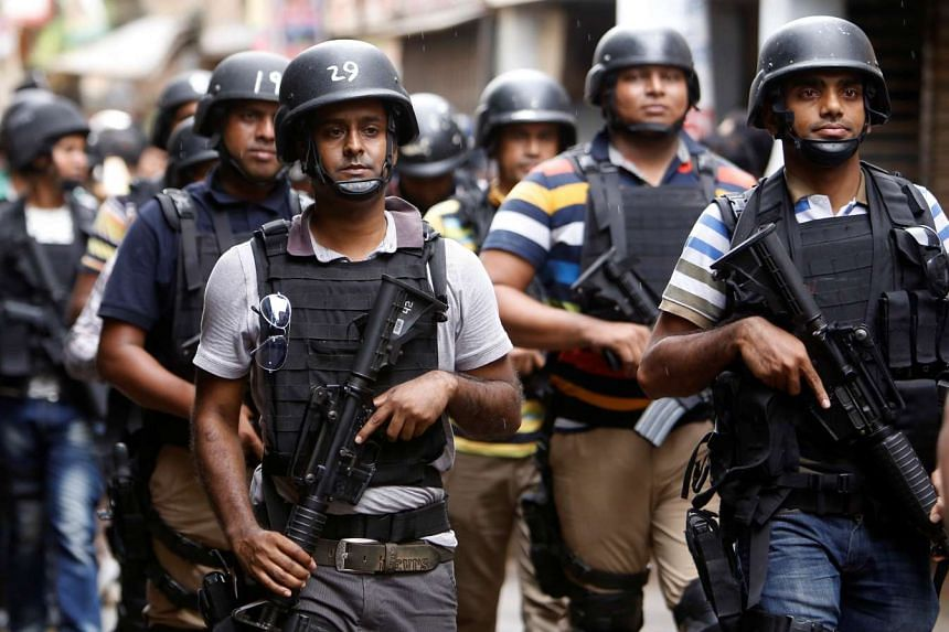 Security personnel leave the site after a police operation on militants on the outskirts of Dhaka, on July 26, 2016.