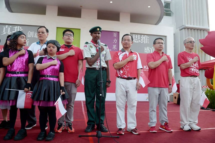 MP Seah Kian Peng and Edwin Tong take the pledge during the Kembangan-Chai Chee National Day Observance Ceremony 2016.