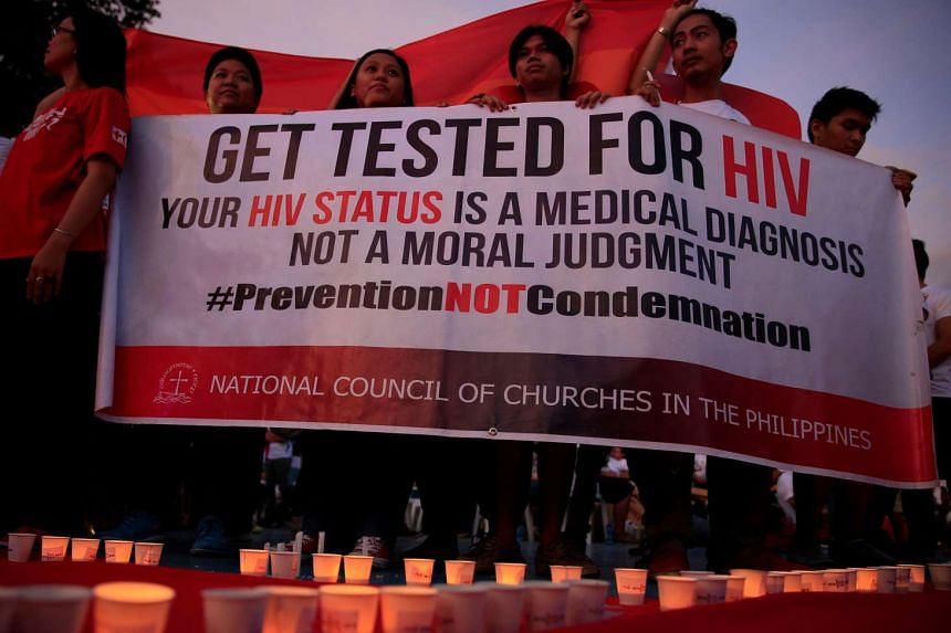 Campaign supporters display a banner at the International Aids Candlelight Memorial Day in Quezon city, on May 14, 2016.