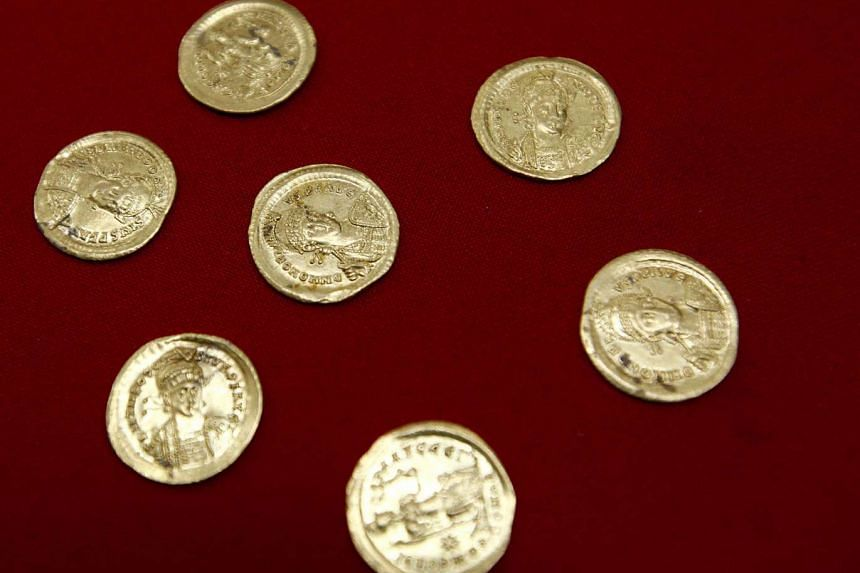 Golden coins uncovered by Serbian archaeologists at the Viminacium site in Serbia on Aug 8, 2016.