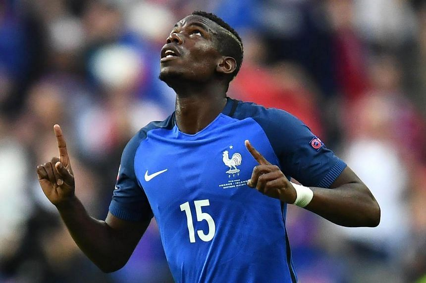 France's midfielder Paul Pogba celebrates after scoring France's second goal during the Euro 2016 QF match between France and Iceland at the Stade de France in Saint-Denis, near Paris, on July 3.