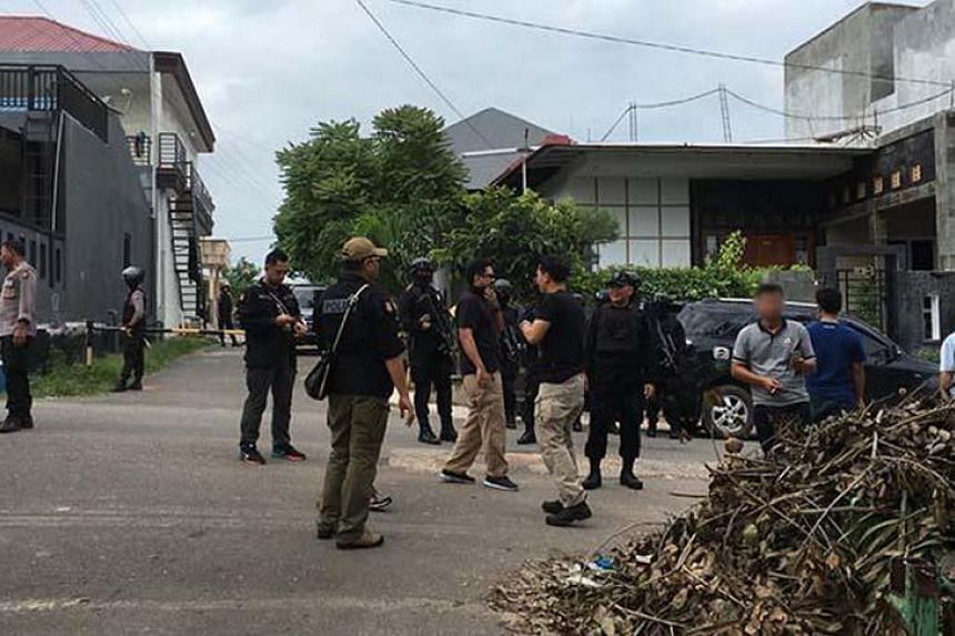 Indonesian police scouring Batam island for other militants from a little-known terror cell, a day after the arrest of six members including its leader who was planning to fire a rocket into Singapore's Marina Bay.