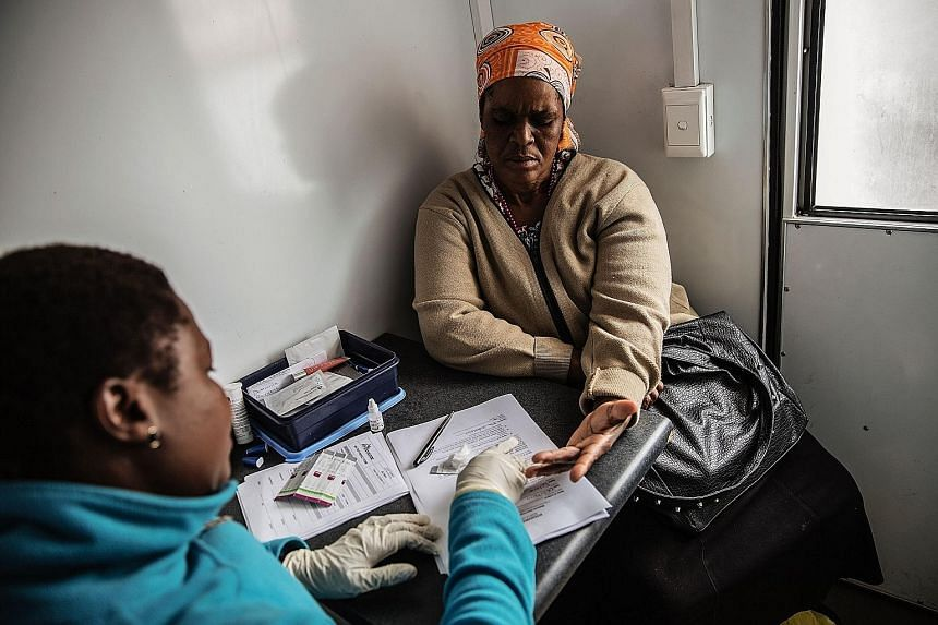 An African woman being tested for HIV. Researchers suspect HIV has spread in Africa because of a mosquito- borne worm that can live in the human lymphatic system for years.